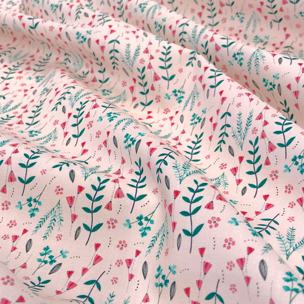 Baumwoll-Stoff zarte Blüten und Zweige auf rosa